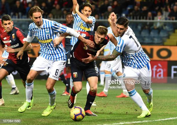 Krzysztof Piatek of Genoa oppose to Simone Missiroli and Kevin Bonifazi of Spal during the Serie A match between Genoa CFC and SPAL at Stadio Luigi...