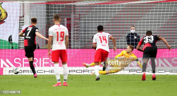 Krzysztof Piatek of Hertha Berlin scores the equalizing goal by penalty kick during the Bundesliga match between RB Leipzig and Hertha BSC at Red...