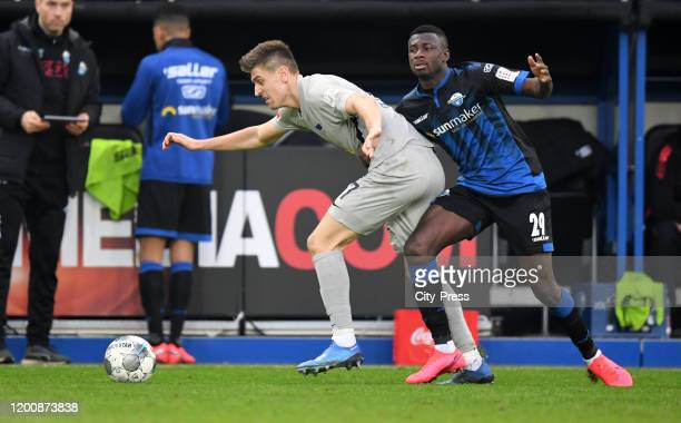 Krzysztof Piatek of Hertha BSC and Jamilu Collins of SC Paderborn during the game between the SC Paderborn 07 against Hertha BSC on february 15 2020...