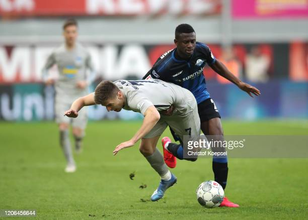 Krzysztof Piatek of Hertha BSC is challenged by Jamilu Collins of SC Paderborn 07 during the Bundesliga match between SC Paderborn 07 and Hertha BSC...