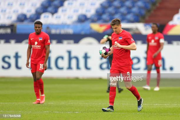 Krzysztof Piatek of Hertha BSC looks dejected after conceding their side's first goal scored by Amine Harit of FC Schalke 04 during the Bundesliga...