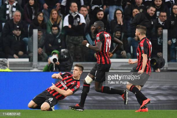 Krzysztof Piatek of Milan celebrates after scoring the opening goal during the Serie A match between Juventus and AC Milan on April 06 2019 in Turin...
