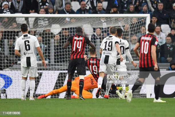 Krzysztof Piatek of Milan scores the opening goal during the Serie A match between Juventus and AC Milan on April 06 2019 in Turin Italy
