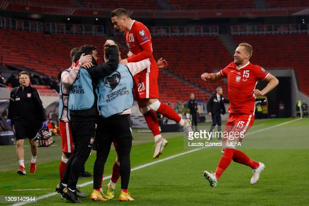 Krzysztof Piatek of Poland celebrates with Piotr Zielinski and Kamil Glik after scoring their side's first goal during the FIFA World Cup 2022 Qatar...