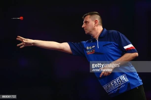 Krzysztof Ratajski of Poland in action during his first round match against James Wilson of England during day one of the 2018 William Hill PDC World...