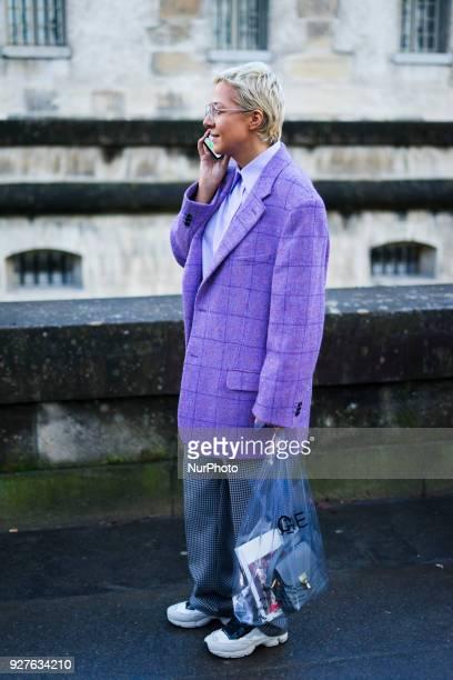 Ksenia Chilingarova wears glasses a purple blazer jacket flare pants outside Valentino during Paris Fashion Week Womenswear Fall/Winter 2018/2019 on...