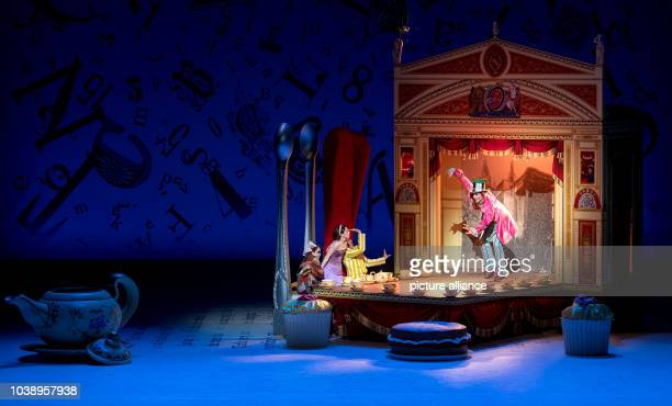 Ksenia Ryzhkova as Alice DustinKlein as the Mad Hatter in action during a photo rehearsal for the show Alice in Wonderland at the NationalTheatre...