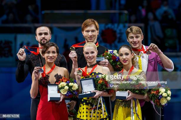 Ksenia Stolbova and Fedor Klimov of Russia Evgenia Tarasova and Vladimir Morozov of Russia Kristina Astakhova and Alexei Rogonov of Russia pose in...