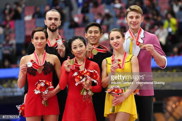 Ksenia Stolbova and Fedor Klimov of Russia Wenjing Sui and Cong Han of China Kristina Astahova and Alexei Rogonov of Russia pose with their medals in...