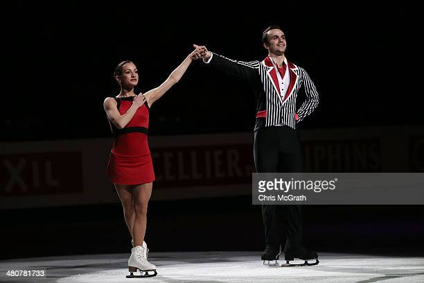 Ksenia Stolbova and Fredor Klimov of Russia celebrate second place during the victory ceremony for the Pairs Free Program during ISU World Figure...
