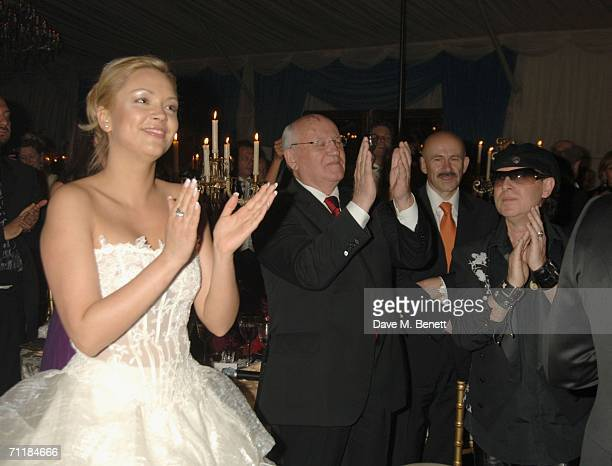 Ksenia Virganskaya, her grandfather, former President of the Soviet Union Mikhail Gorbachev, and Klaus Meinethe applaud during the Raisa Gorbachev...