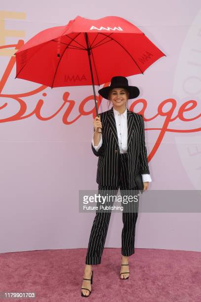 Ksenija Lukich arrives in the rain on Derby Day at the 2019 Melbourne Cup Carnival at Flemington Racecourse in Melbourne Australia- PHOTOGRAPH BY...