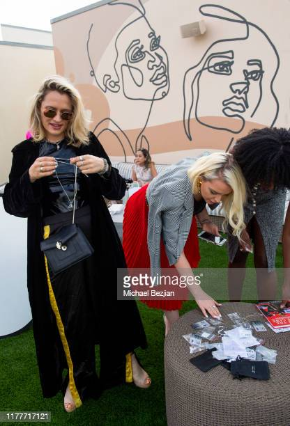 Kseniya Durst and Katie Welch look at custom Jewelry by Jimeye Designs at TAP visits The McCord List on September 27 2019 in Los Angeles California