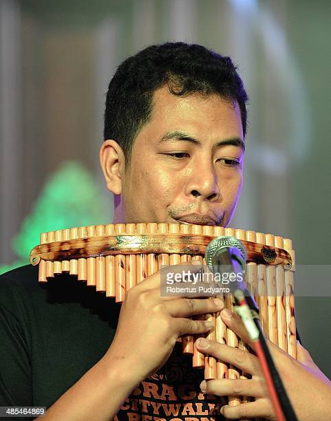 Kseven musician of Philippines plays bamboo pan flute during the Braga Bamboo Festival at Braga Citywalk on April 18 2014 in Bandung Java Indonesia...
