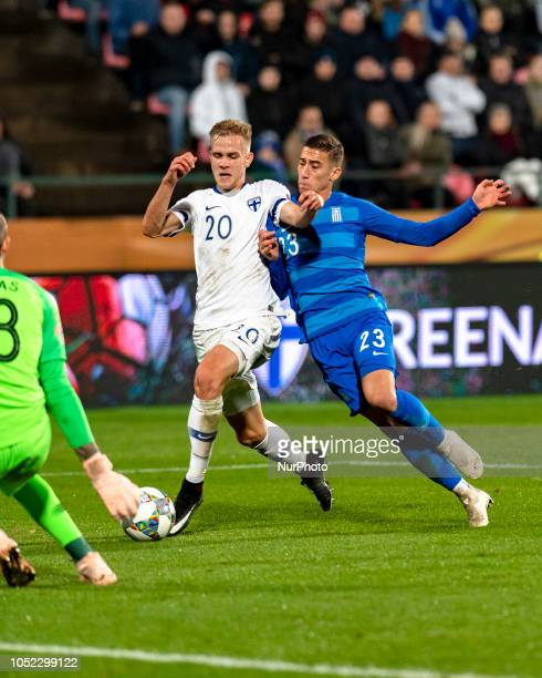 Kstas Tsimikas of Greece and Jasse Tuominen of Finland vie for the ball during the UEFA Nations League group stage football match Finland v Grece in...