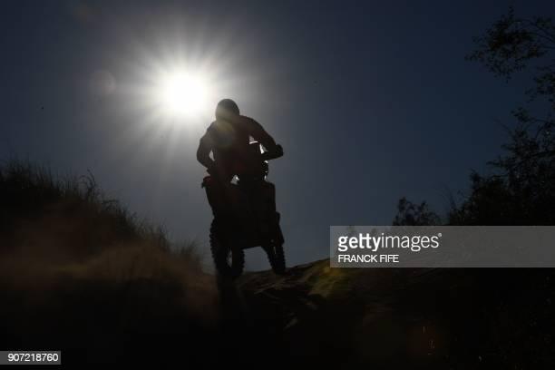 TOPSHOT Ktm's Austrian biker Matthias Walkner competes during Stage 13 of the 2018 Dakar Rally between San Juan and Cordoba in Argentina on January...