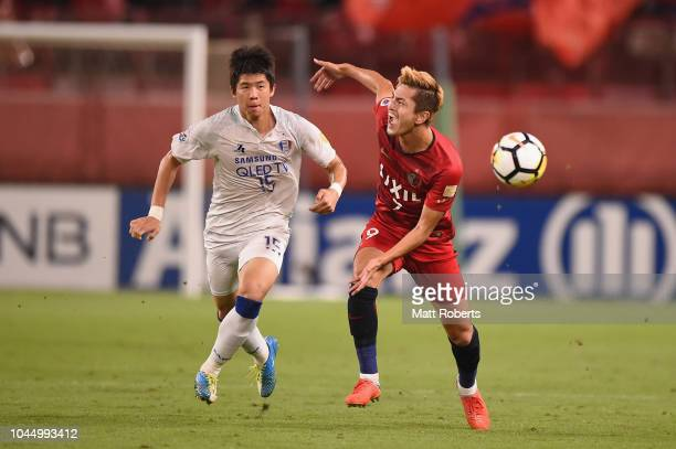 Ku Jaryong of Suwon Samsung Bluewings competes for the ball against Yuma Suzuki of Kashima Antlers during the AFC Champions League semi final first...