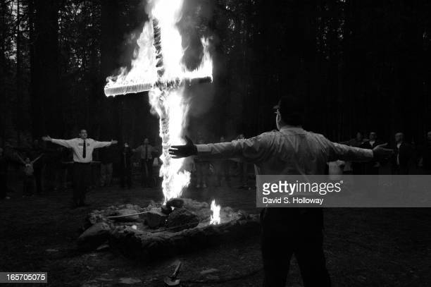 Ku Klux Klan Imperial Wizard Bradley Jenkins leads participants through a cross lighting ceremony during Aryan Nations' World Congress held at...