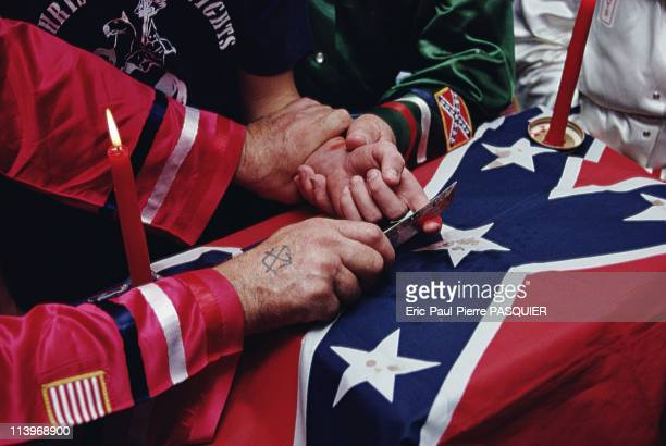 Ku Klux Klan In United StatesA newly recruited member showing his allegiance to the Klan by spilling a few drops of his blood on the Confederate flag