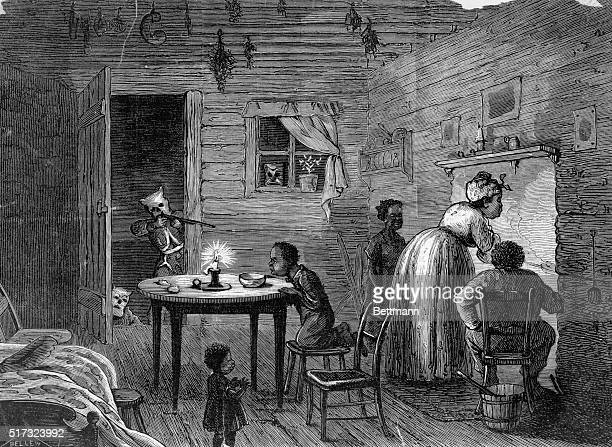 Ku Klux Klan member aiming weapon into home of African American slaves. Visit of the Ku Klux. Drawn by Frank Bellew. Undated.