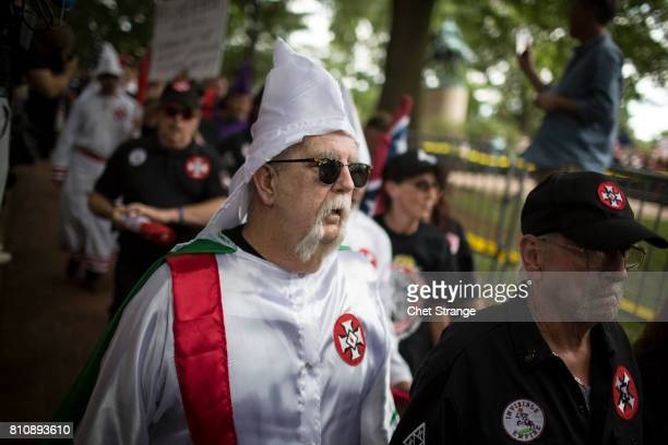 Ku Klux Klan member is escorted out of Justice Park after a planned protest by the Klan on July 8 2017 in Charlottesville Virginia The KKK is...
