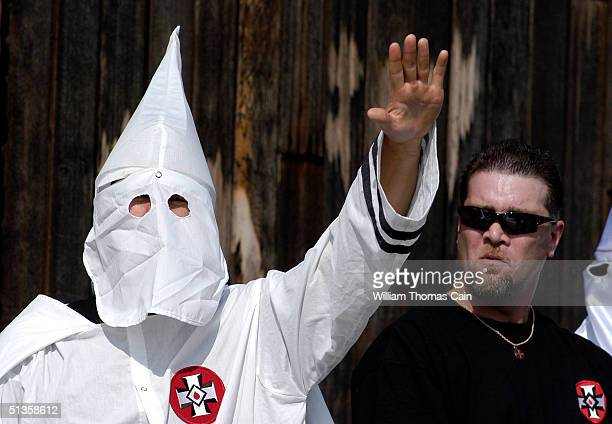 Ku Klux Klan member salutes during an American Nazi Party rally at Valley Forge National Park September 25 2004 in Valley Forge Pennsylvania Hundreds...