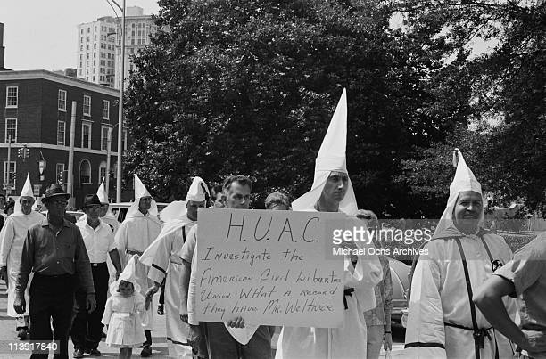 Ku Klux Klan members at a rally in Atlanta Georgia USA 6 August 1965 The farright KKK members dressed in robes and conical hats carry a banner...