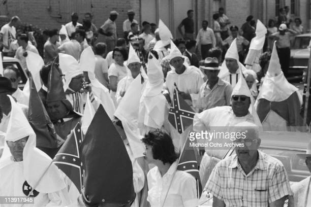 Ku Klux Klan members at a rally in Atlanta, Georgia, USA, 6 August 1965. The far-right KKK members, dressed in white robes and conical hats, are also...