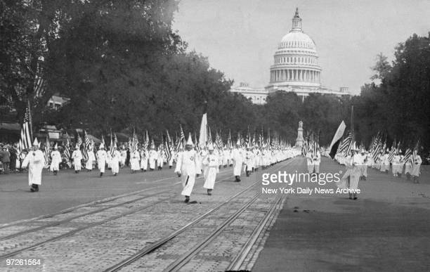Ku Klux Klan members march in a parade down Pennsylvania Avenue from the capitol to the treasury in Washington D.C., 8th August 1925.