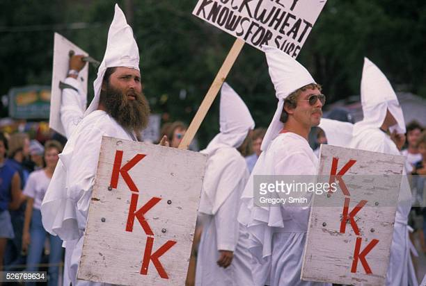 Ku Klux Klan members march through downtown Houston under heavy police protection