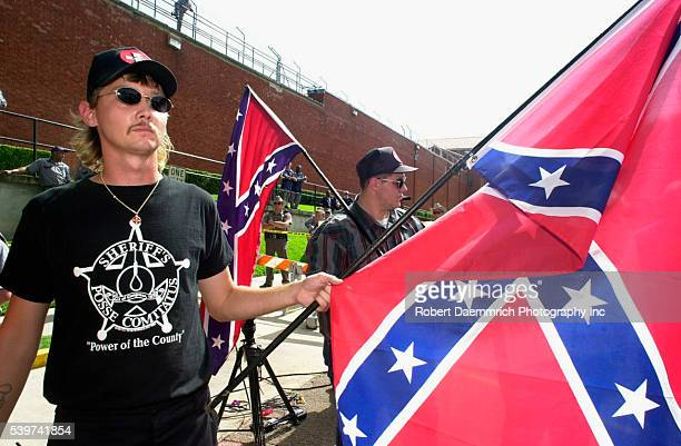 Ku Klux Klan members stand with Confederate flags outside the Walls Unit of the Texas Dept of Corrections before the execution of Gary Graham