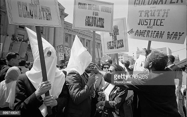 Ku Klux Klan members supporting Barry Goldwater's campaign for the presidential nomination at the Republican National Convention, as an African...