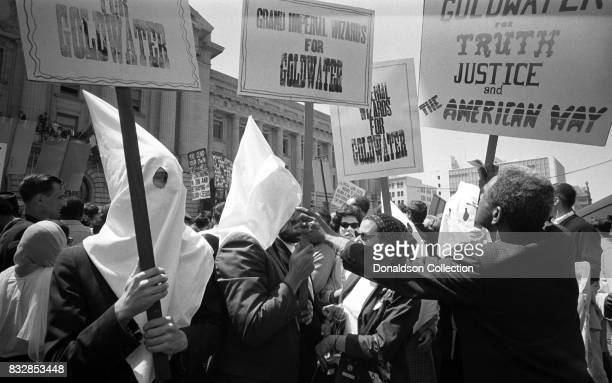Ku Klux Klan members supporting Barry Goldwater's campaign for the presidential nomination at the Republican National Convention on July 12 1964 in...