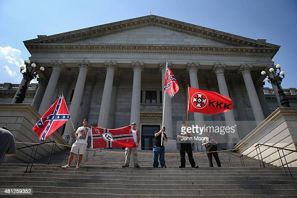Ku Klux Klan members take part in a Klan demonstration at the state house building on July 18 2015 in Columbia South Carolina The KKK protested the...