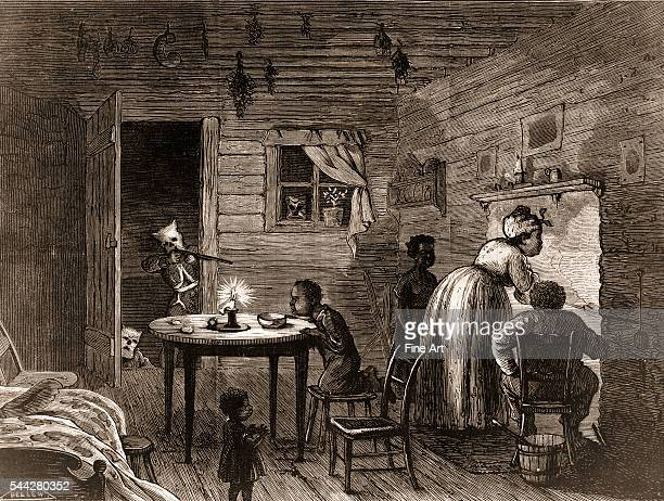 Ku Klux Klan members with hoods and rifles attack an AfricanAmerican home in the South wood engraving by Frank Bellew 1872