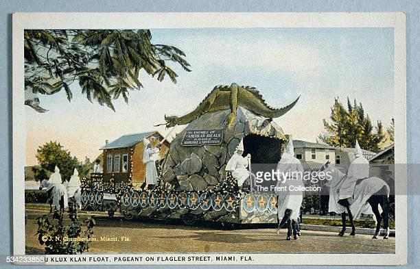 Ku Klux Klan postcard showing klansman on horseback in full regalia beside an elaborate float at Pageant Day in Miami Florida