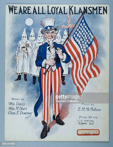 Ku Klux Klan sheet music published in Pennsylvania in the 1920s shows Uncle Sam holding an American flag and leading a group of hooded klansmen