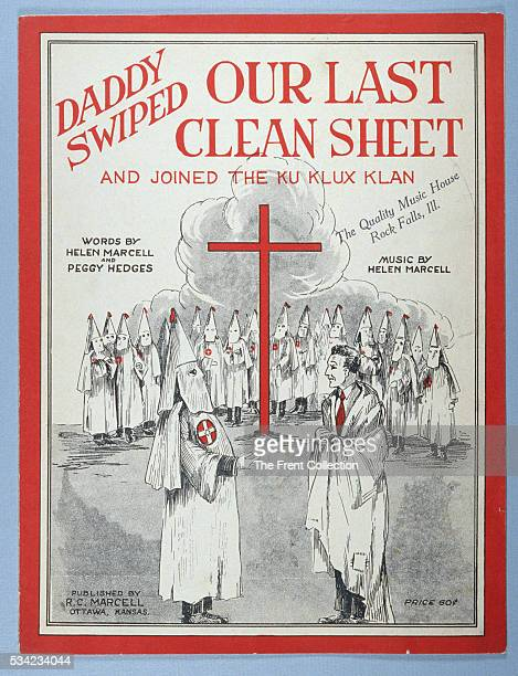 Ku Klux Klan sheet music titled Daddy Swiped Our Last Clean Sheet and Joined the Ku Klux Klan shows klansman with outstretched arm welcoming new...