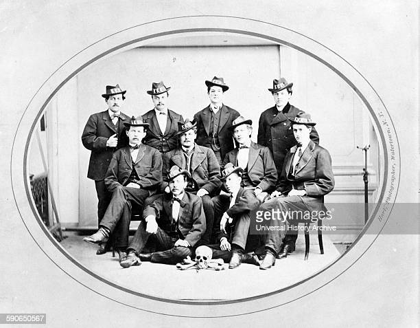 Ku Klux Klan Watertown Division 289 Photograph shows ten men posed seated and standing wearing hats with KKK in large letters and with a skull and...