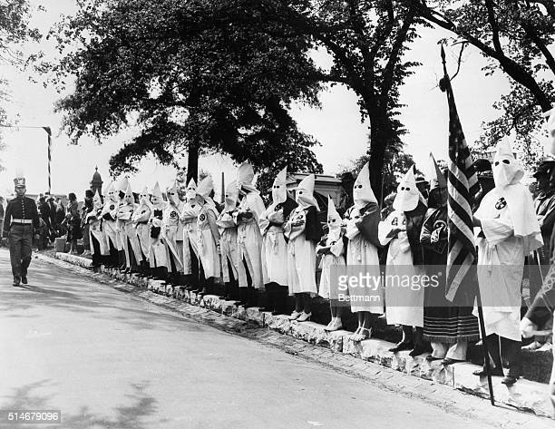 Ku Klux Klansmen and their families stand along the driveway of Oakland Cemetery in Atlanta during a memorial service for the Confederate States' war...