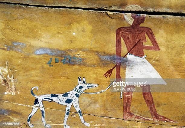 Ku with his dog Meniu Pu, decorative detail of Ku's sarcophagus, from Assiut. Egyptian civilisation, Middle Kingdom. Cairo, Egyptian Museum
