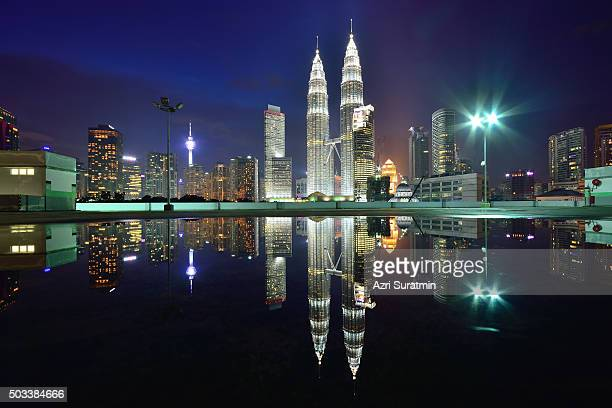 Kuala Lumpur city during blue hour with reflection.