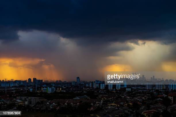 Kuala Lumpur city view with dark clouds and rain pouring to the city.