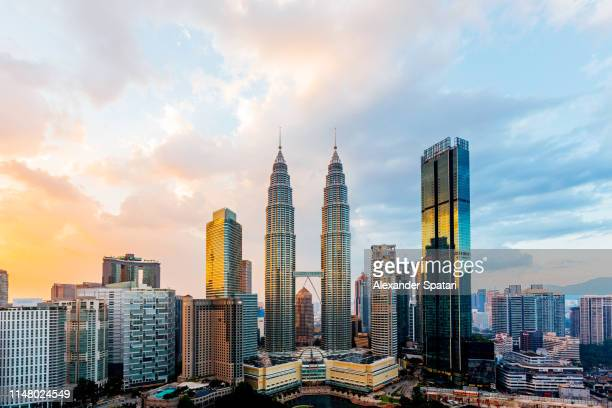 kuala lumpur cityscape with petronas towers at sunset, malaysia - south east asia stock pictures, royalty-free photos & images