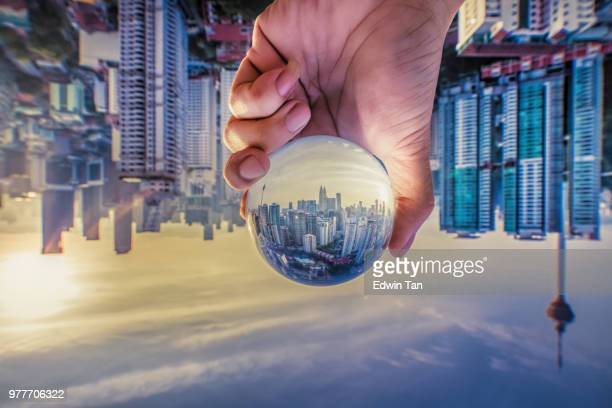 kuala lumpur in dusk hour see thru crystal ball - upside down stock pictures, royalty-free photos & images