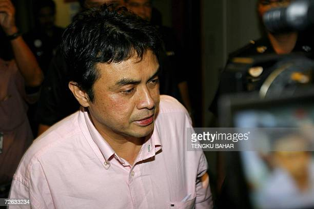 Abdul Razak Baginda charged for abetting the murder of Mongolian model Altantuya Shaariibuu is escorted out of the Malaysian High Court after his...