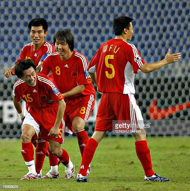 Kuala Lumpur, MALAYSIA: China's Wang Dong celebrates with his teammates after scoring his team's fifth goal during their Asian Football Cup Group C...