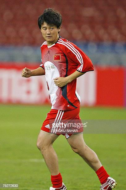 Kuala Lumpur, MALAYSIA: Chinese football player Sun Jihai trains during an Asian Football Cup stadium training session at the Bukit Jalil Stadium in...
