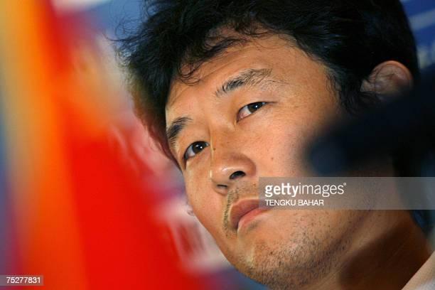 Kuala Lumpur, MALAYSIA: Chinese national football player Sun Jihai looks on during a press conference in Kuala Lumpur, 09 July 2007, on the eve of...