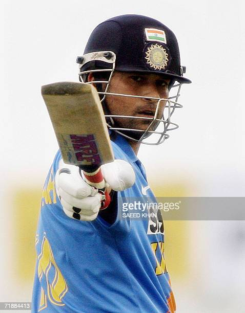 Indian star batsman Sachin Tendulkar acknowledges the crowd after completing his unbeaten century in the second oneday match of the triangular series...